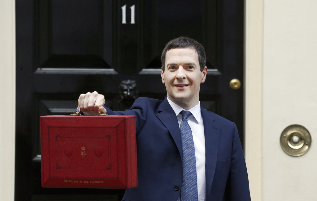 FILE - In this Wednesday, March 16, 2016, file photo, Britain's Chancellor of the Exchequer George Osborne poses for the media with the...