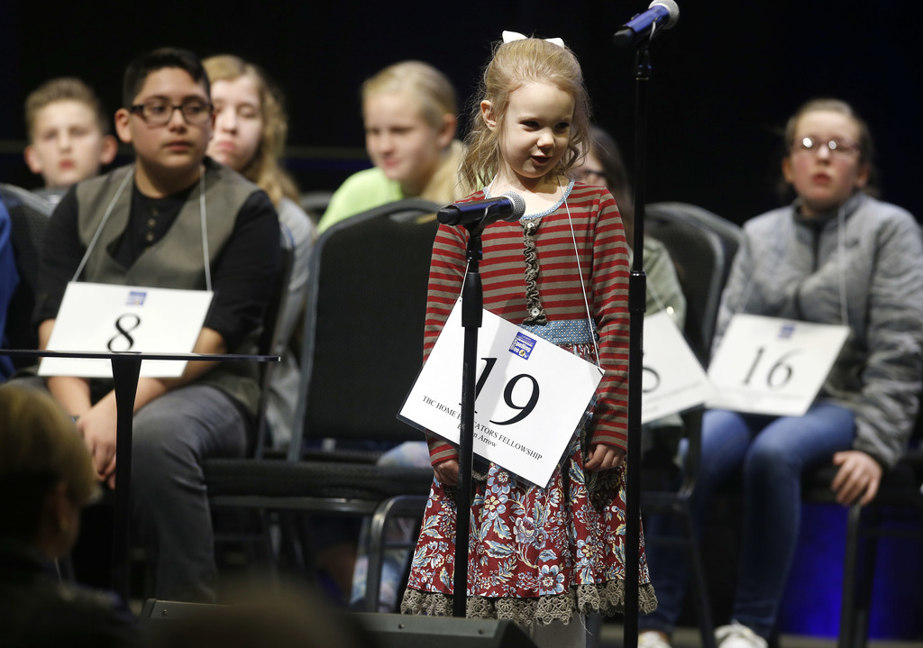 In this March 4, 2017, photo, Edith Fuller, 5, spells a word during the 2017 Scripps Green Country Regional Spelling Bee in Tulsa, Okla...