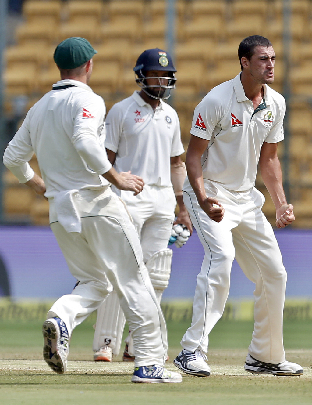Australia's Mitchell Starc, right, celebrates the dismissal of India's Karun Nair during the fourth day of their second test cricket ma...