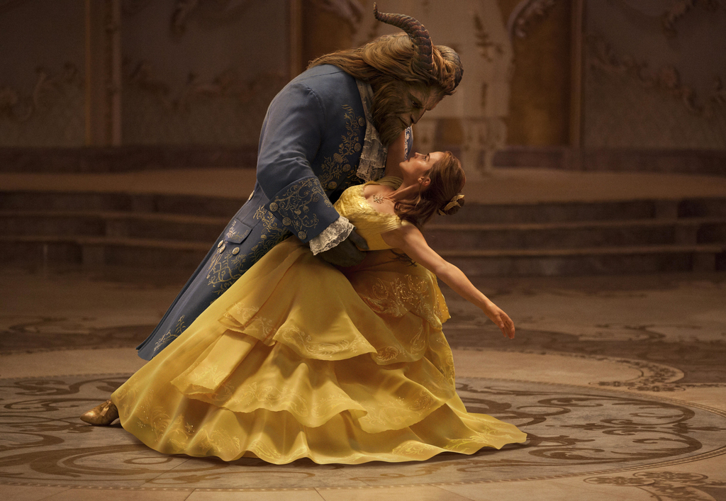 This image released by Disney shows Dan Stevens as The Beast, left, and Emma Watson as Belle in a live-action adaptation of the animate...