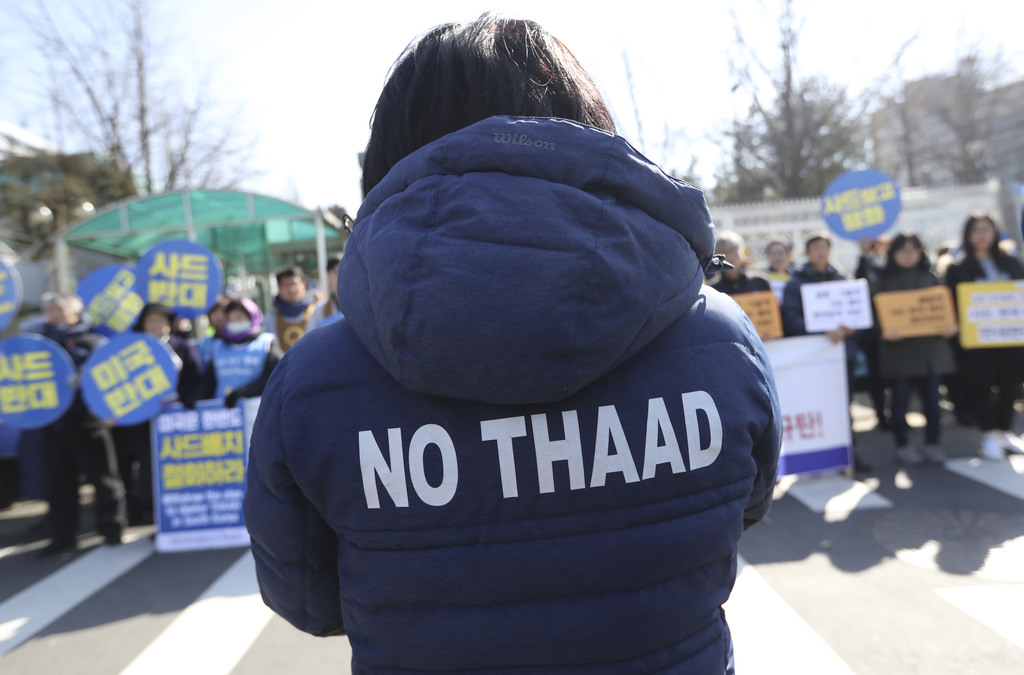 """A protester wearing a jacket with """"No THAAD"""" letters, participates during a rally to oppose the plan to deploy the Terminal High-Altitu..."""