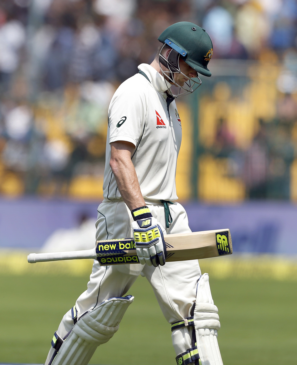 Australia's captain Steven Smith leaves the field after being dismissed during the fourth day of their second test cricket match agains...