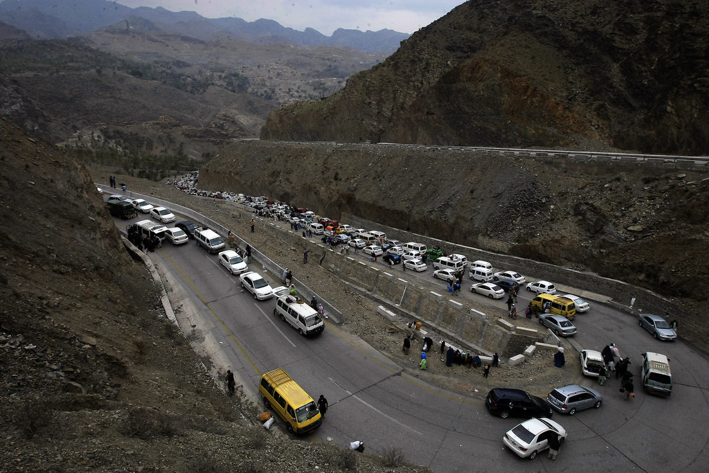 Vehicles carrying Afghan nationals, travel through Pakistan's famous Khyber Pass en route to neighboring Afghanistan in Pakistan, Tuesd...