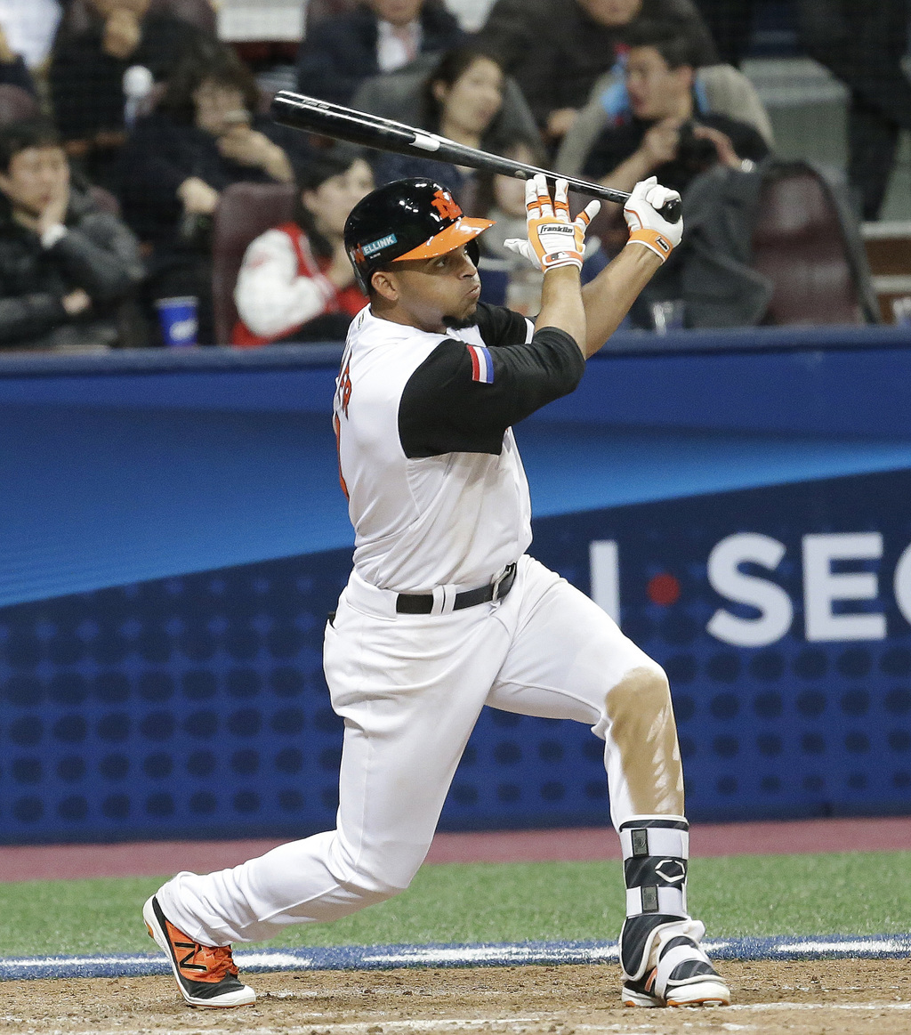 Netherlands's Randolph Oduber hits a two-run home against South Korea's pitcher Won Jonghyun during the 6th inning of their first round...