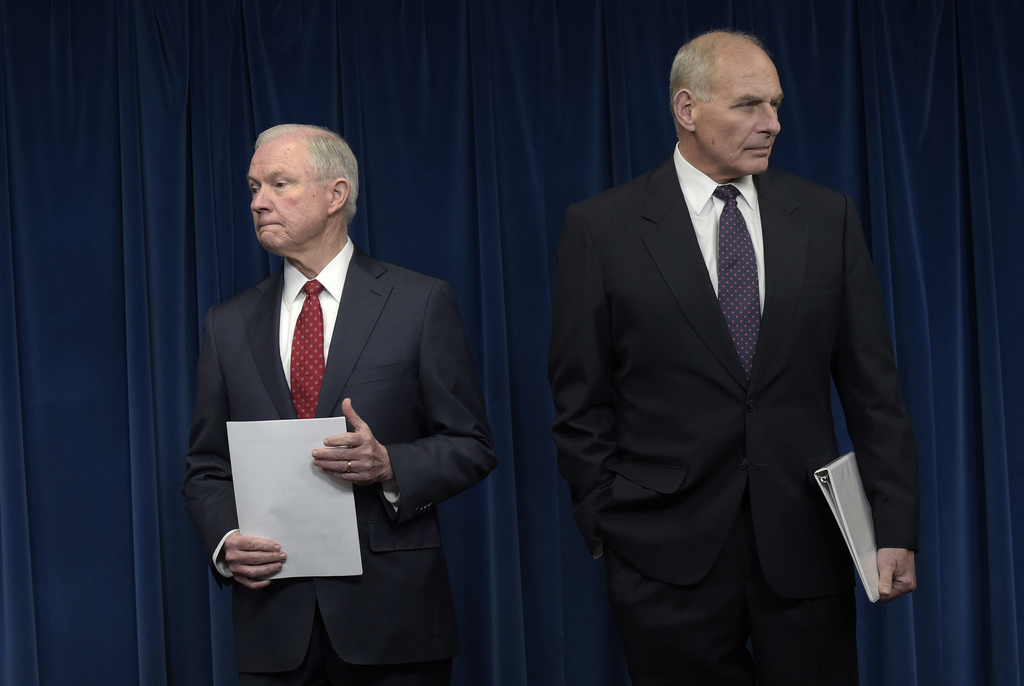 Attorney General Jeff Sessions, left, and Homeland Security Secretary John Kelly, right, wait to make a statements on issues related to...