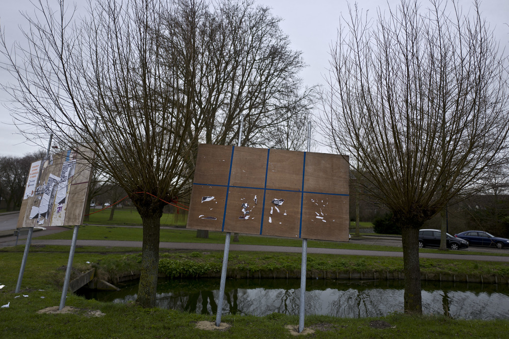 In this Friday, March 3, 2017 photo, an election billboard with torn posters that read partly Geert, referring to Geert Wilders leader ...