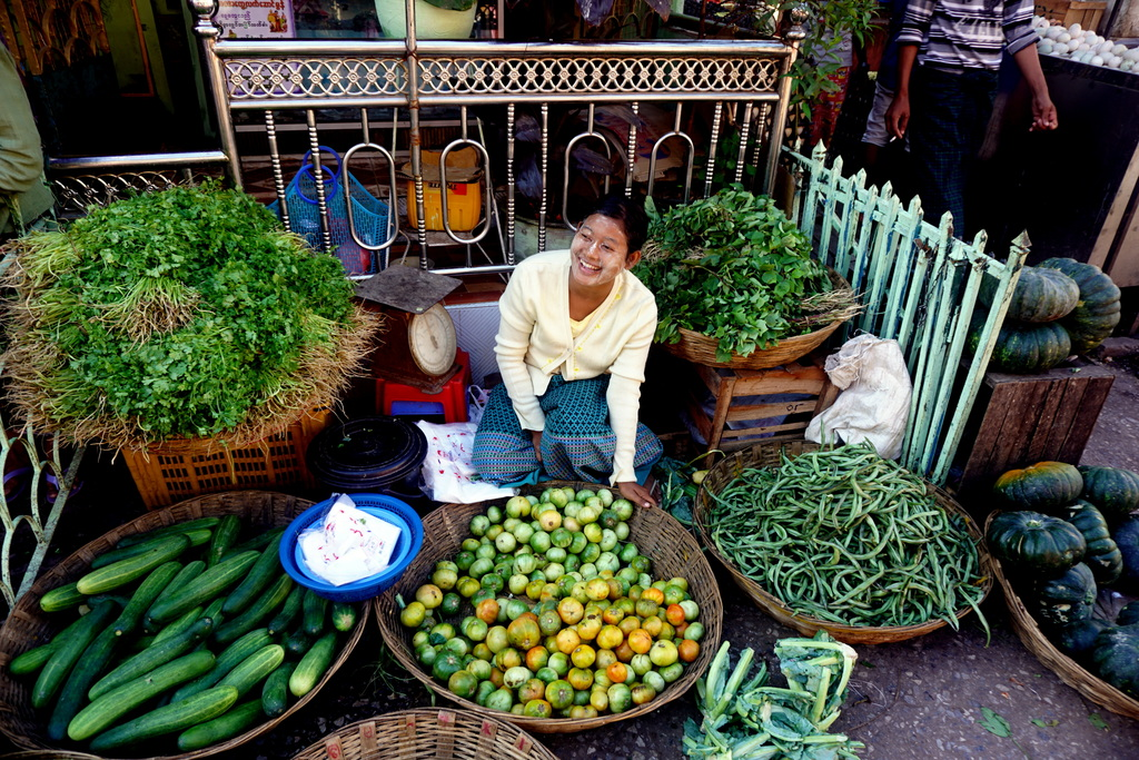 In this Jan. 25, 2017 photo, a vendor sits among her vegetable offerings in Mawlamyine. It is one of Myanmar's great markets, where smu...