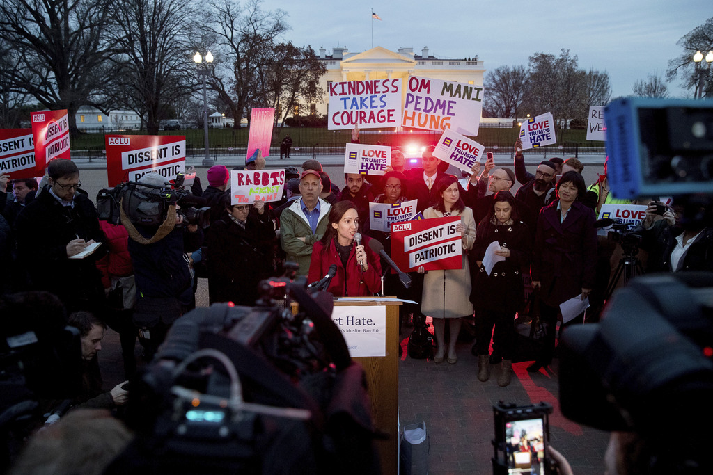 People gather for a protest against President Donald Trump's new travel ban order in Lafayette Park outside the White House, Monday, Ma...