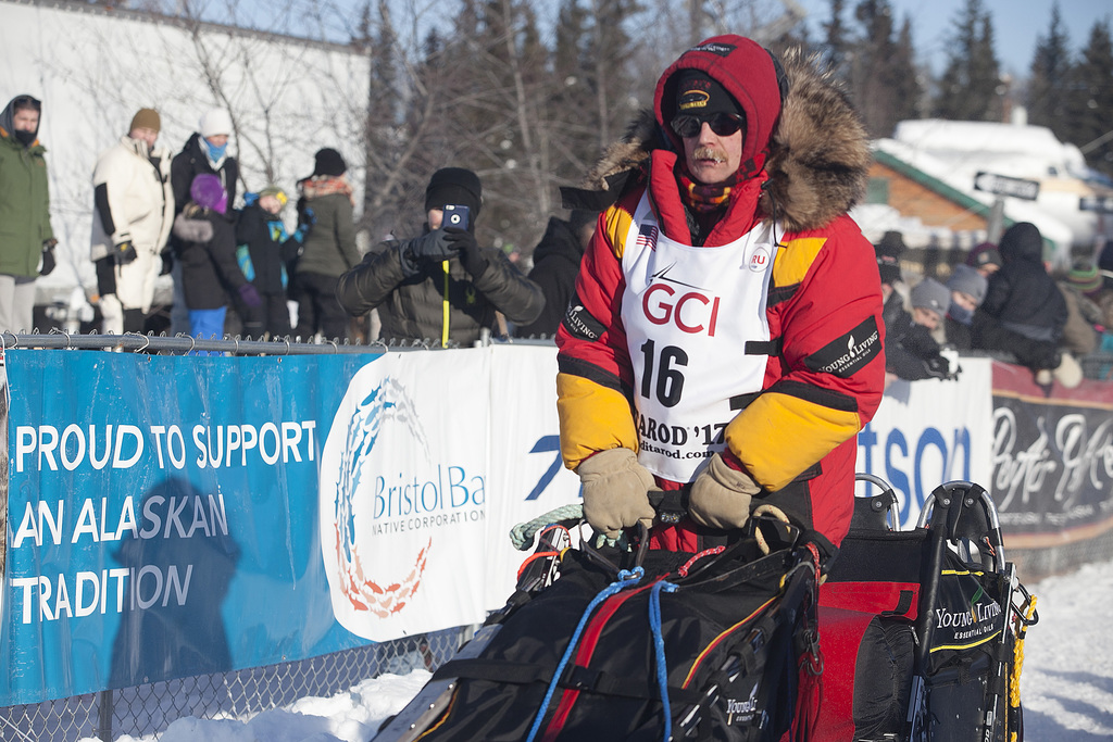 Two-time Iditarod champion Mitch Seavey takes off two positions ahead of his son, reigning champion Dallas Seavey, at the start of the ...