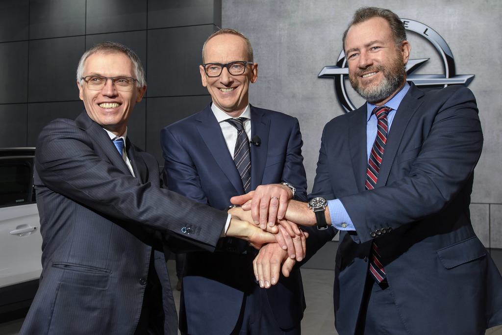 Carlos Tavares, left, CEO of PSA Peugeot Citroen, Karl-Thomas Neumann, center, CEO of Opel Group and President of General Motors Dan Am...
