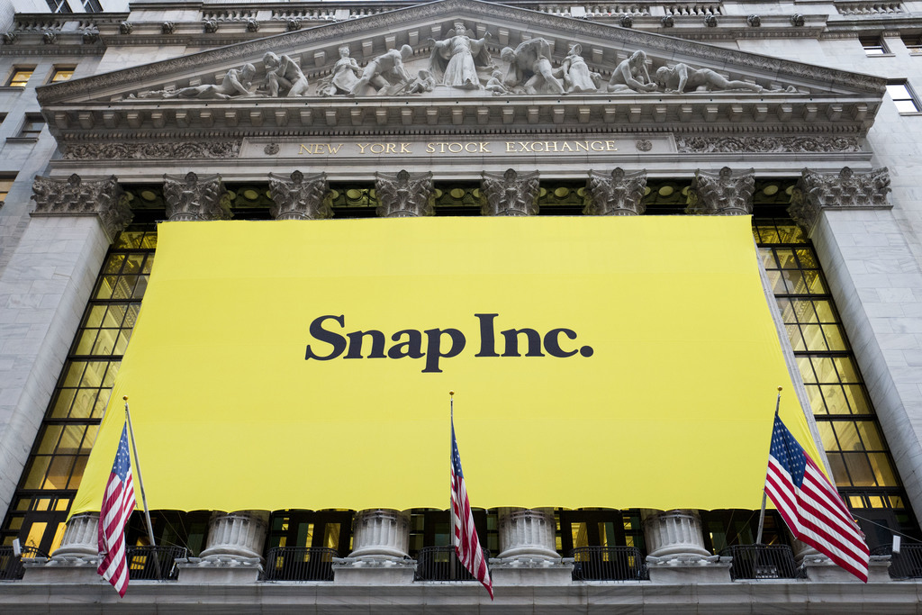 FILE - In this March 2, 2017 file photo, a banner for Snap Inc. hangs from the front of the New York Stock Exchange, in New York.  Snap...