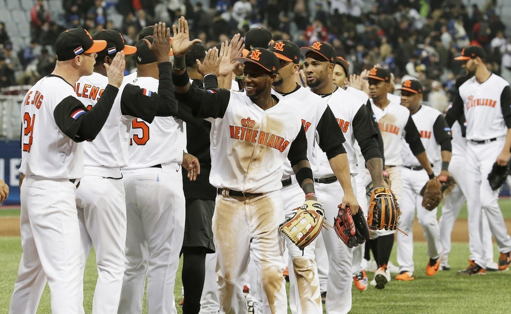Netherlands team celebrate their victory against South Korea after first round game of the World Baseball Classic at Gocheok Sky Dome i...
