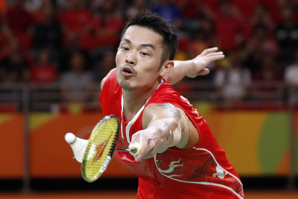 FILE- In this Saturday, Aug. 20, 2016 file photo, China's Lin Dan returns a shot to Denmark's Viktor Axelsen during the men's badminton...