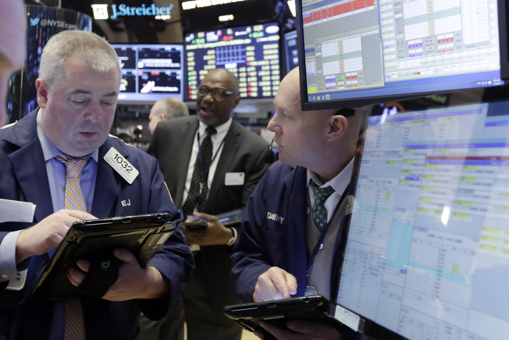 Traders Edward McCarthy, left, and Daniel Leporin, right, work on the floor of the New York Stock Exchange, Tuesday, March 7, 2017. Sto...