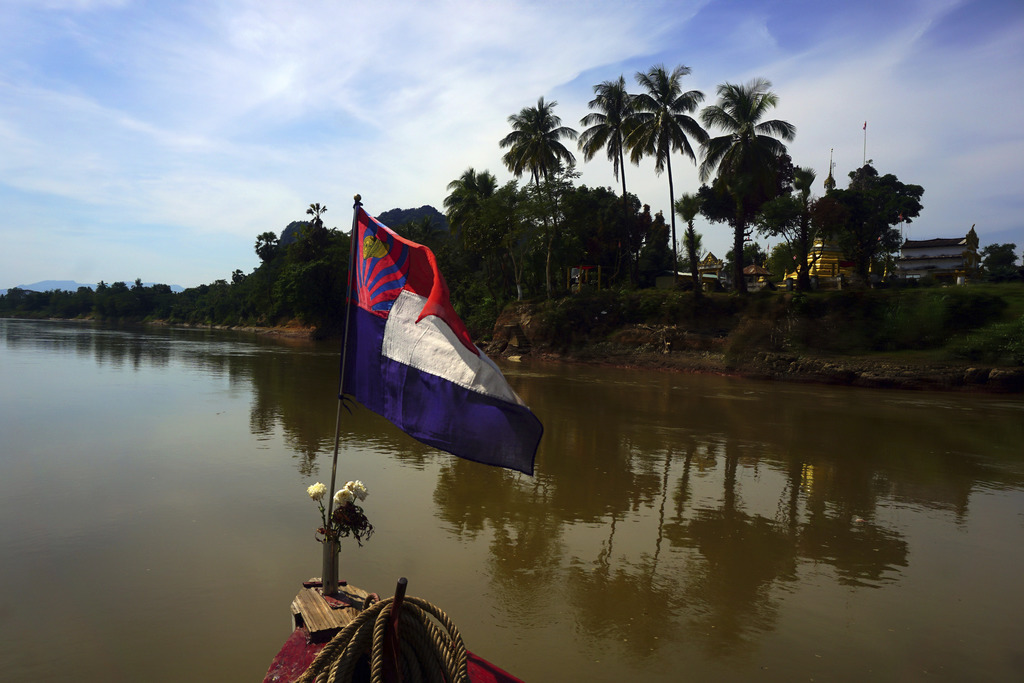 In this Jan. 23, 2017 photo, Buddhist temples and villages dot the shoreline of the Salween River as it flows toward Mawlamyine and the...