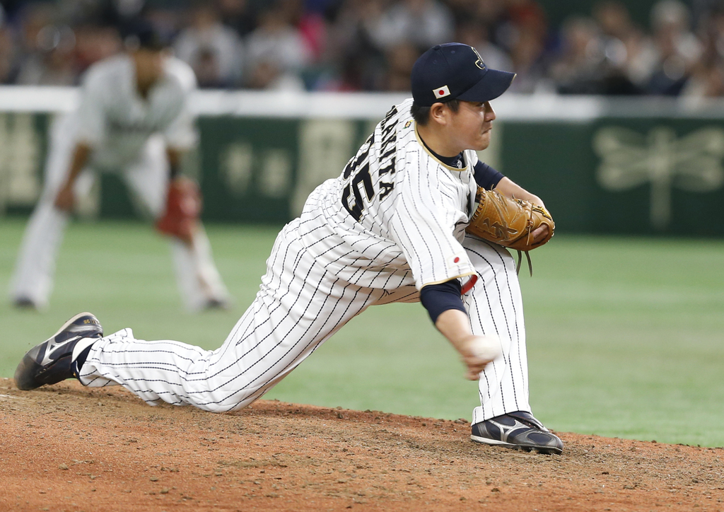 Japan's closer Kazuhisa Makita pitches against Cuba in the ninth inning to win their first round game 11-6 at the World Baseball Classi...