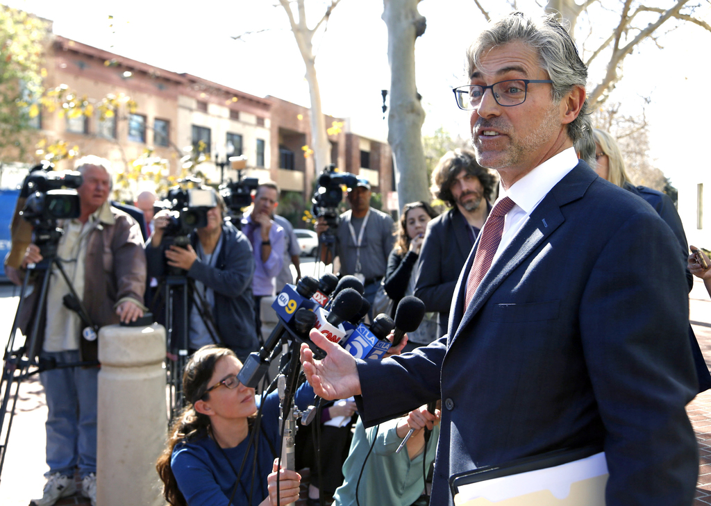 Attorney Robert Blume speaks to reporters outside federal court in Santa Ana, Calif., after an Afghan family of five who had traveled t...