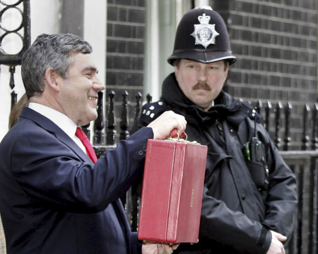 FILE - In this Wednesday March 16, 2005 file photo, Britain's Chancellor of the Exchequer Gordon Brown holds up his red budget box as h...