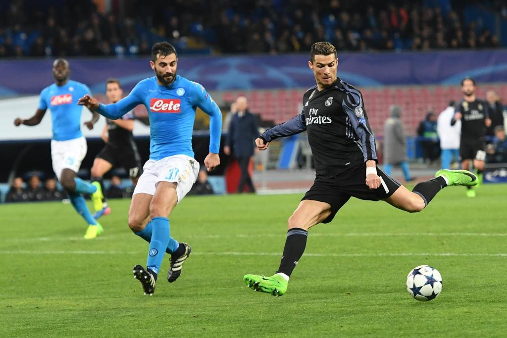 Napoli's Raul Albiol, left, and Real Madrid's Cristiano Ronaldo vie for the ball during a Champions League, round of 16, return-leg soc...
