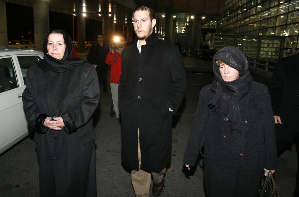 FILE--In this Dec. 18, 2007, file photo, Christine Levinson, left, the wife of a missing American former FBI agent, her son, Daniel, an...