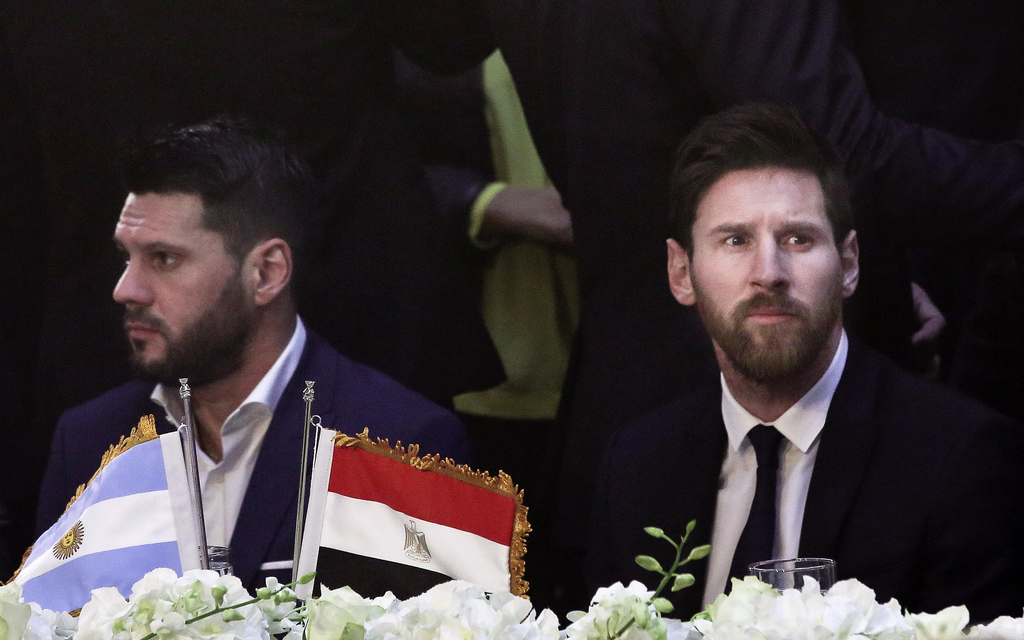FILE - In this Tuesday, Feb. 21, 2017, file photo, FC Barcelona's Lionel Messi, right, attends a gala dinner held at the Mena House in ...
