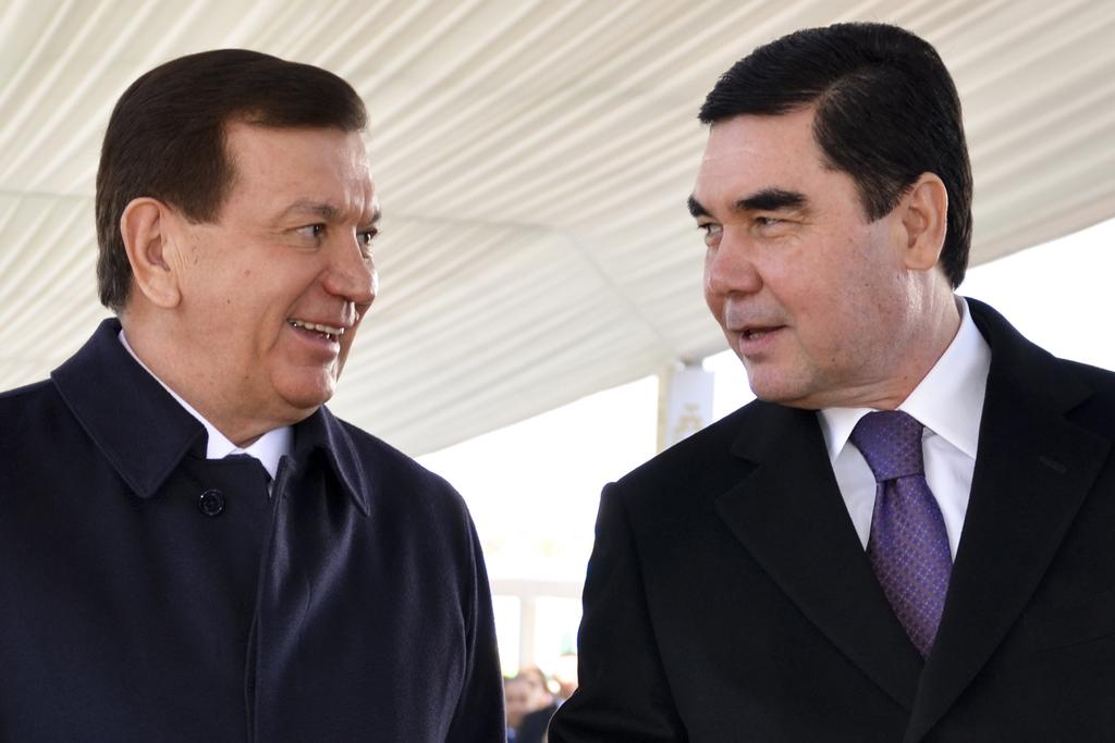 Turkmen President, Gurbanguli Berdymukhamedov, right, and his Uzbek counterpart, Shavkat Mirziyoyev ,attend the opening ceremony of a n...
