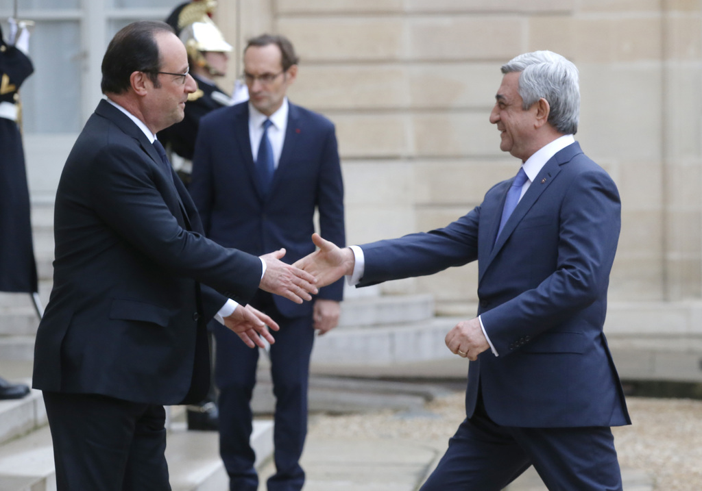 France's President Francois Hollande, left, welcomes Armenia's President Serge Sarkissian at the Elysee Palace, Wednesday, March 8, 201...