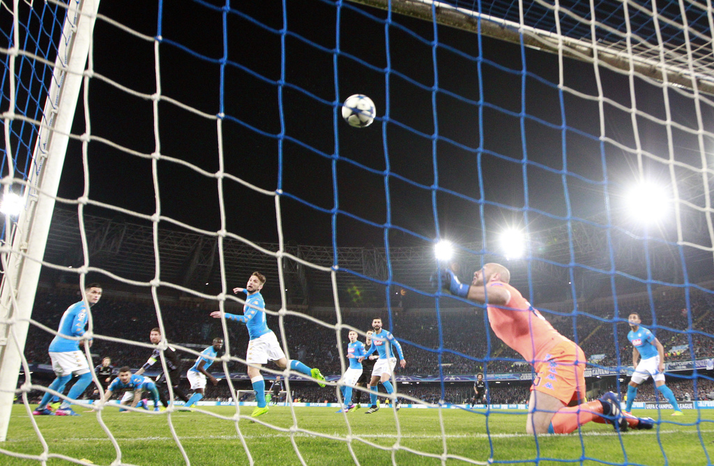 A header from Real Madrid's Sergio Ramos, in the background left, is deflected into the goal by Napoli's Dries Mertens, center, to give...