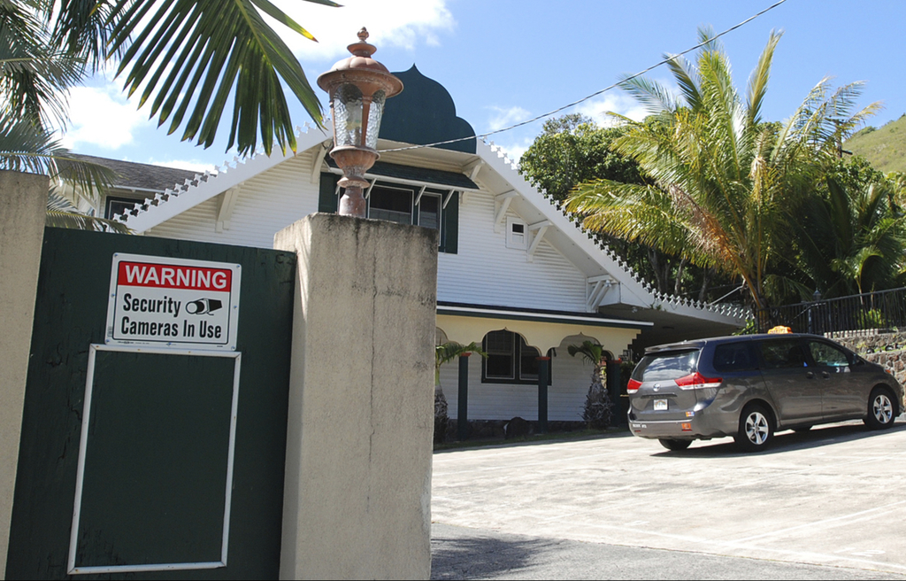 FILE - In this Feb. 9, 2017 file photo, a security camera warning sign is seen at the Muslim Association of Hawaii in Honolulu. The sta...