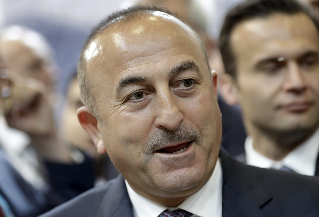 The Foreign Minister of Turkey Mevlut Cavusoglu speaks during a visit of the booth of Turkey at the tourism fair ITB in Berlin, Germany...