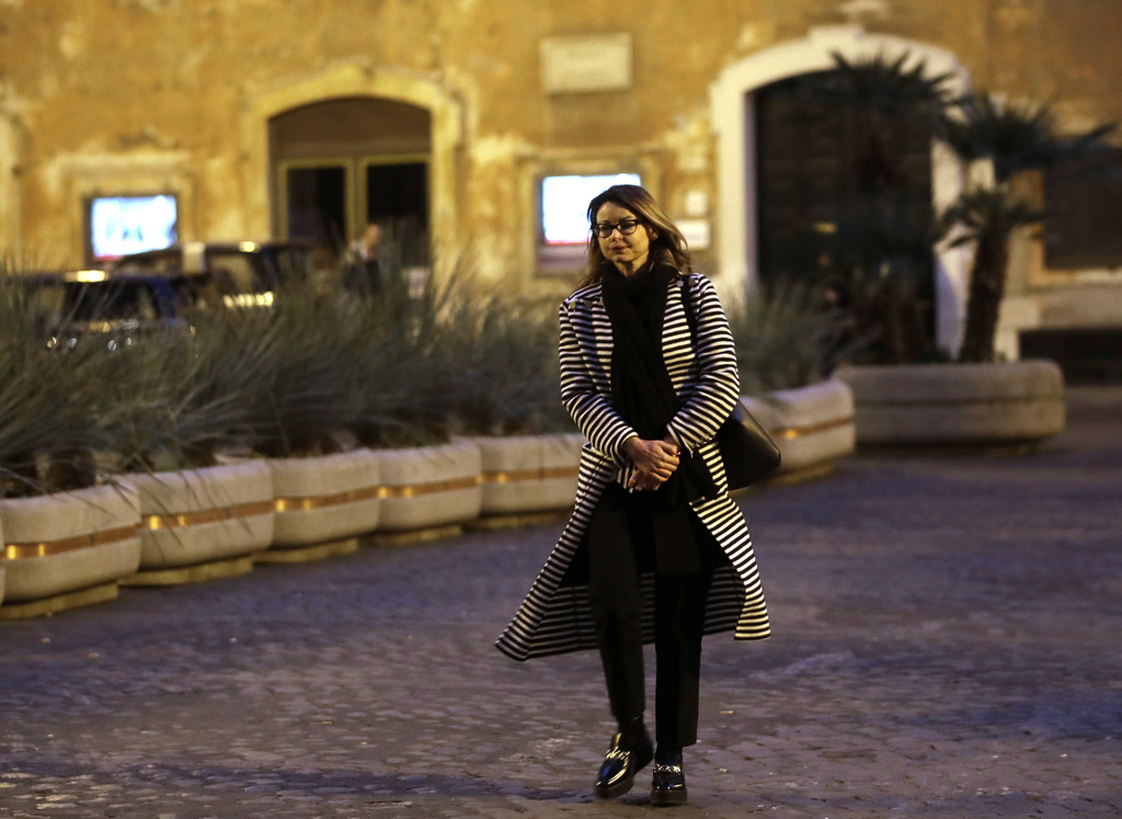 In this photo taken on Tuesday, Feb. 21, 2017, Lucia Annibali, victim of an acid attack, walks in Rome. A rebellion against gender viol...