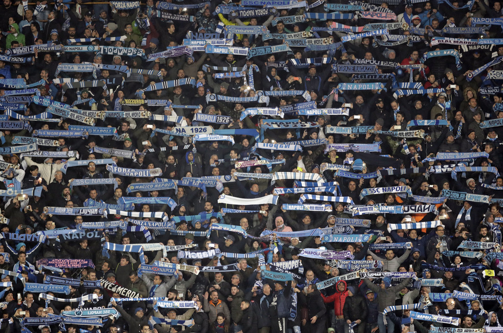 Napoli supporters hold up their scarves during the Champions League round of 16, second leg, soccer match between Napoli and Real Madri...