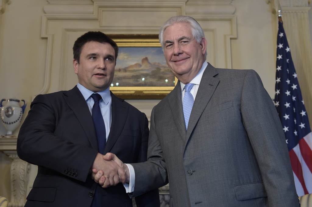 Secretary of State Tillerson shakes hands with Ukrainian Foreign Minister Pavlo Klimkin, at the State Department in Washington, Tuesday...