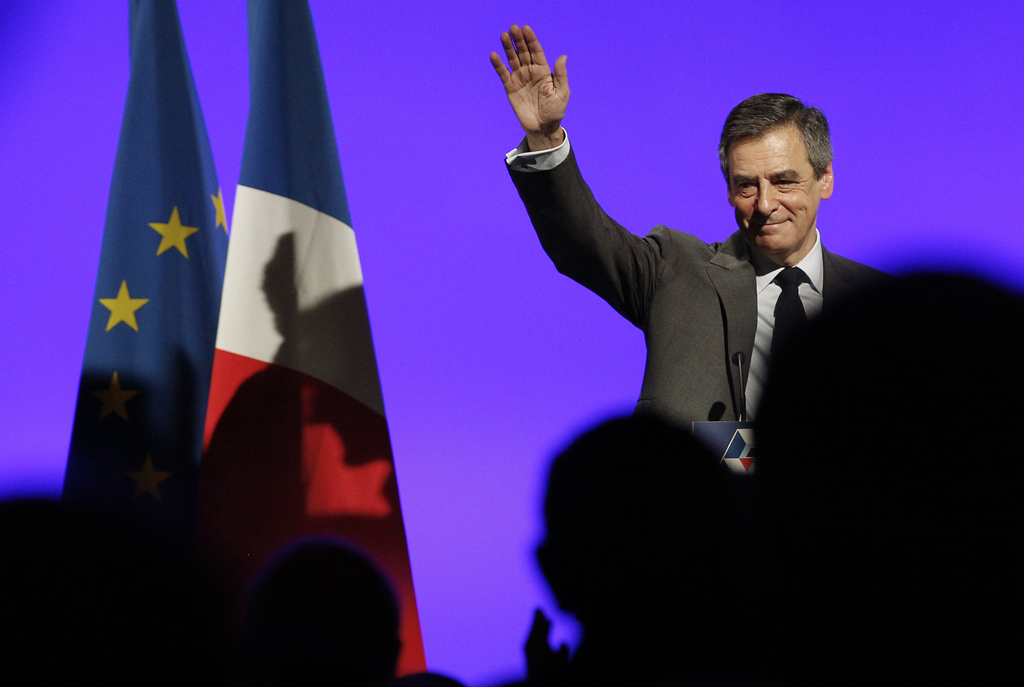 French conservative presidential candidate Francois Fillon, waves after delivering his speech during a rally in Orleans, central France...