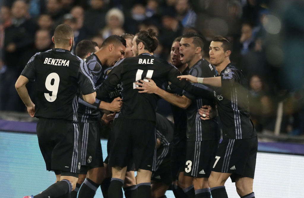 Real Madrid players celebrate after Sergio Ramos scored their first goal during the Champions League round of 16, second leg, soccer ma...