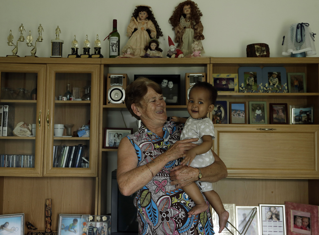 Monica Barnard, a part-time nanny, holds 8 months old girl Amya Tsolo at her house in Johannesburg, South Africa, Monday, March 6, 2017...
