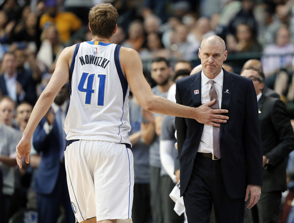 Dallas Mavericks' Dirk Nowitzki (41) of Germany taps head coach Rick Carlisle on the chest as he walks off the court during a time out ...