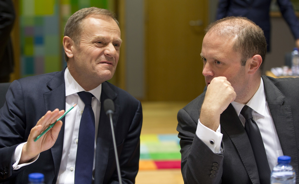 European Council President Donald Tusk, left, speaks with Malta's Prime Minister Joseph Muscat as they wait for the start of a pre-EU s...
