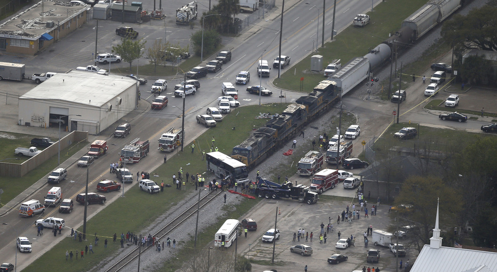 Responders works the scene where a train hit a bus in Biloxi, Miss., Tuesday, March 7, 2017.  A freight train smashed into a charter bu...