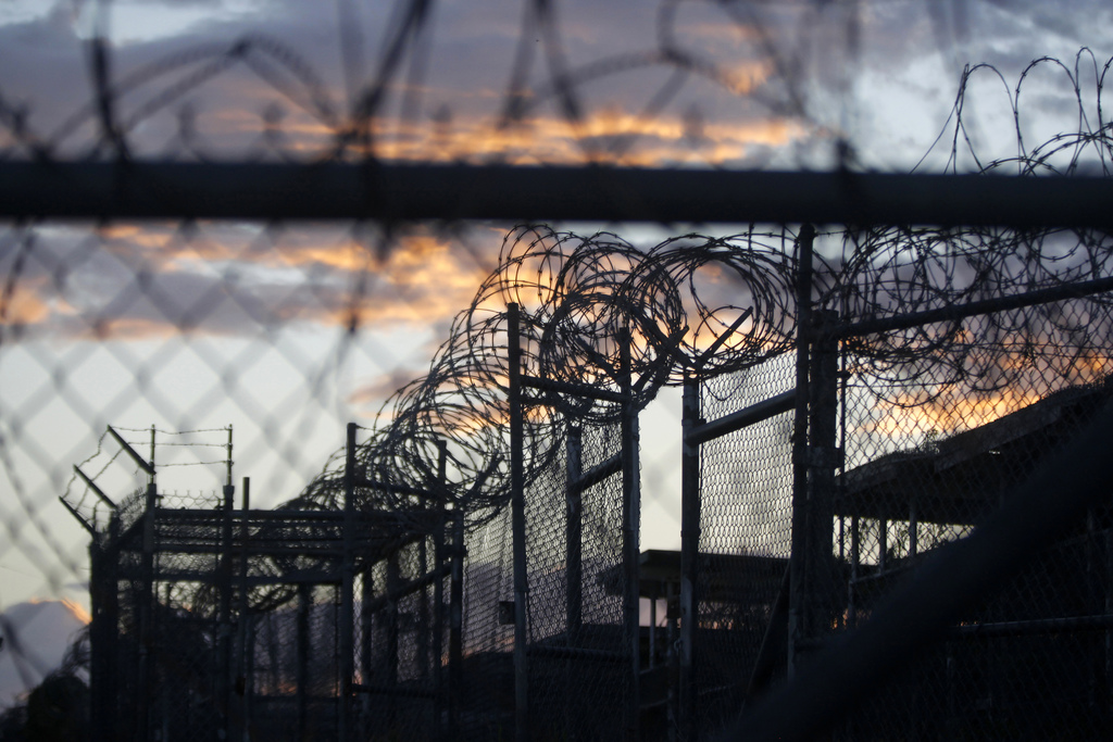 FILE - In this Nov. 21, 2013 file photo reviewed by the U.S. military, dawn arrives at the now closed Camp X-Ray, which was used as the...
