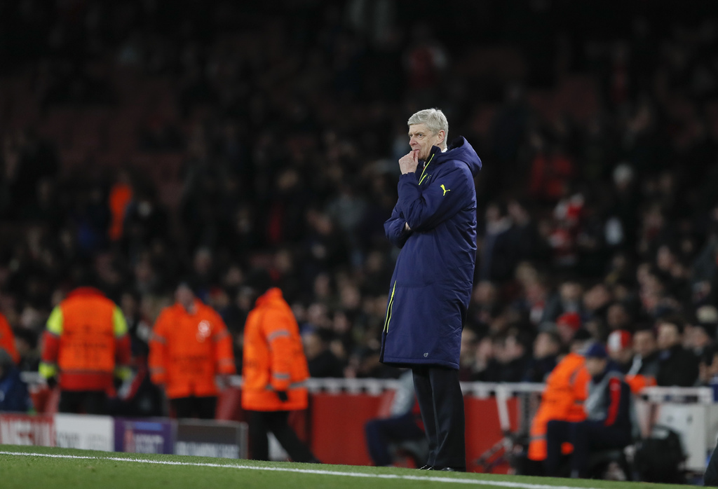 Arsenal manager Arsene Wenger gestures during the Champions League round of 16 second leg soccer match between Arsenal and Bayern Munic...