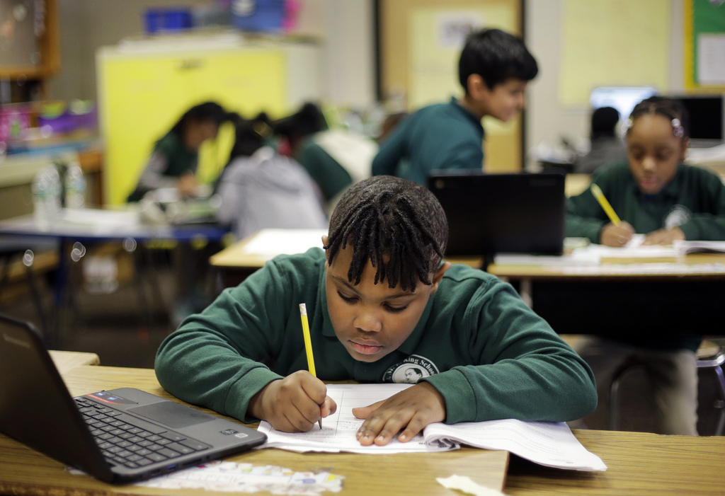 In this Feb. 23, 2017 photo, Justin Beckles works on a project in his third-grade classroom at the Martin Luther King Jr. Elementary Sc...
