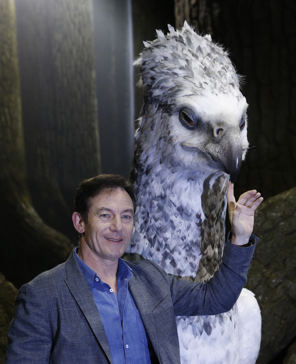 Actor Jason Isaacs poses for the media next to Buckbeak at a new extension called the 'Forbidden Forest' to the Warner Brothers studio ...