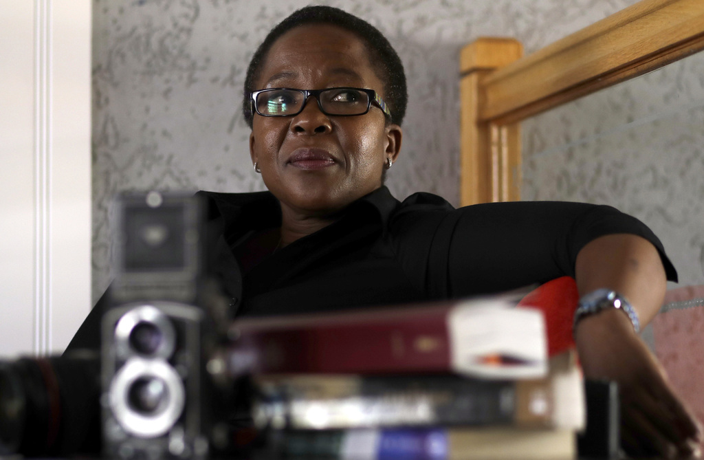 Ruth Seopedi Motau, 49, a photographer and a church minister in Winchester Hills, south of Johannesburg, South Africa, Monday, March 6,...