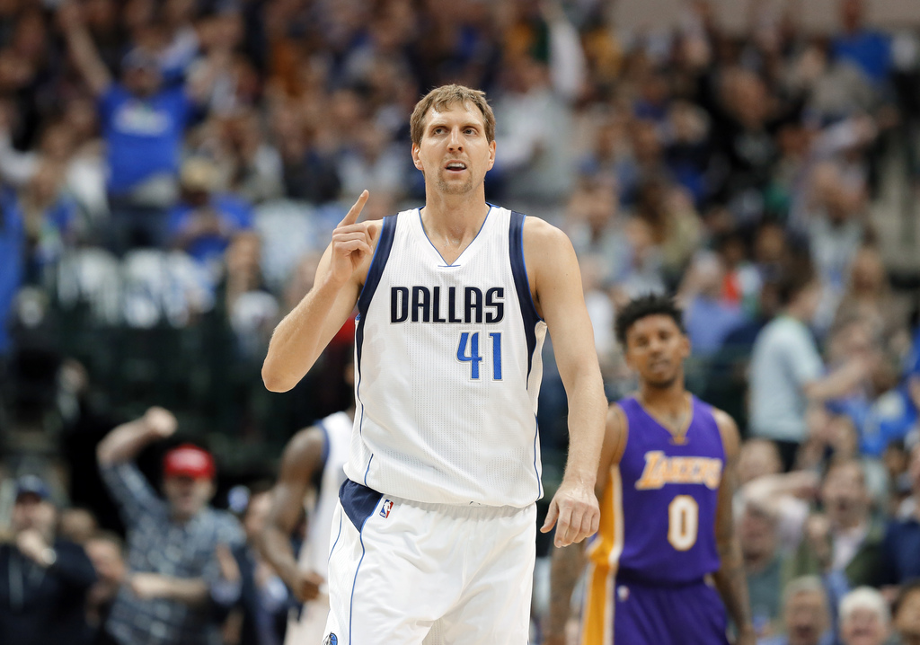 Dallas Mavericks forward Dirk Nowitzki (41) of Germany celebrates sinking a three-point basket early in the first quarter of an NBA bas...