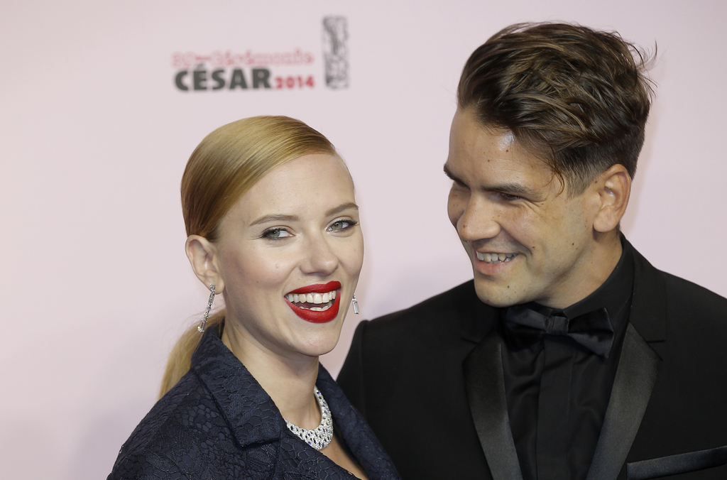 FILE - In this Feb. 28, 2014, file photo, U.S. actress Scarlett Johansson, left, and her partner Romain Dauriac arrive at the 39th Fren...