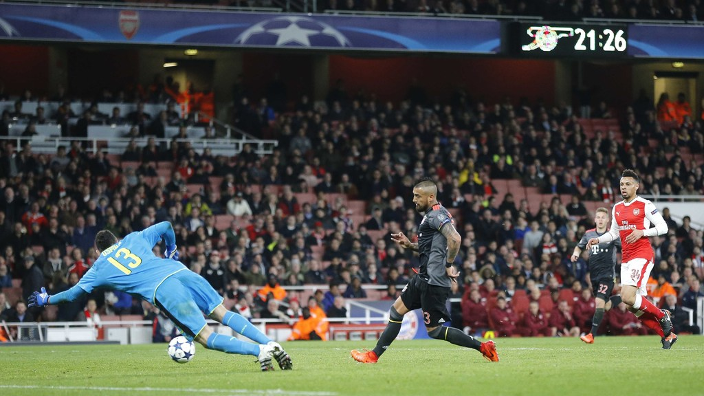 Bayern's Arturo Vidal scores his side's fifth goal past Arsenal goalkeeper David Ospina during the Champions League round of 16 second ...