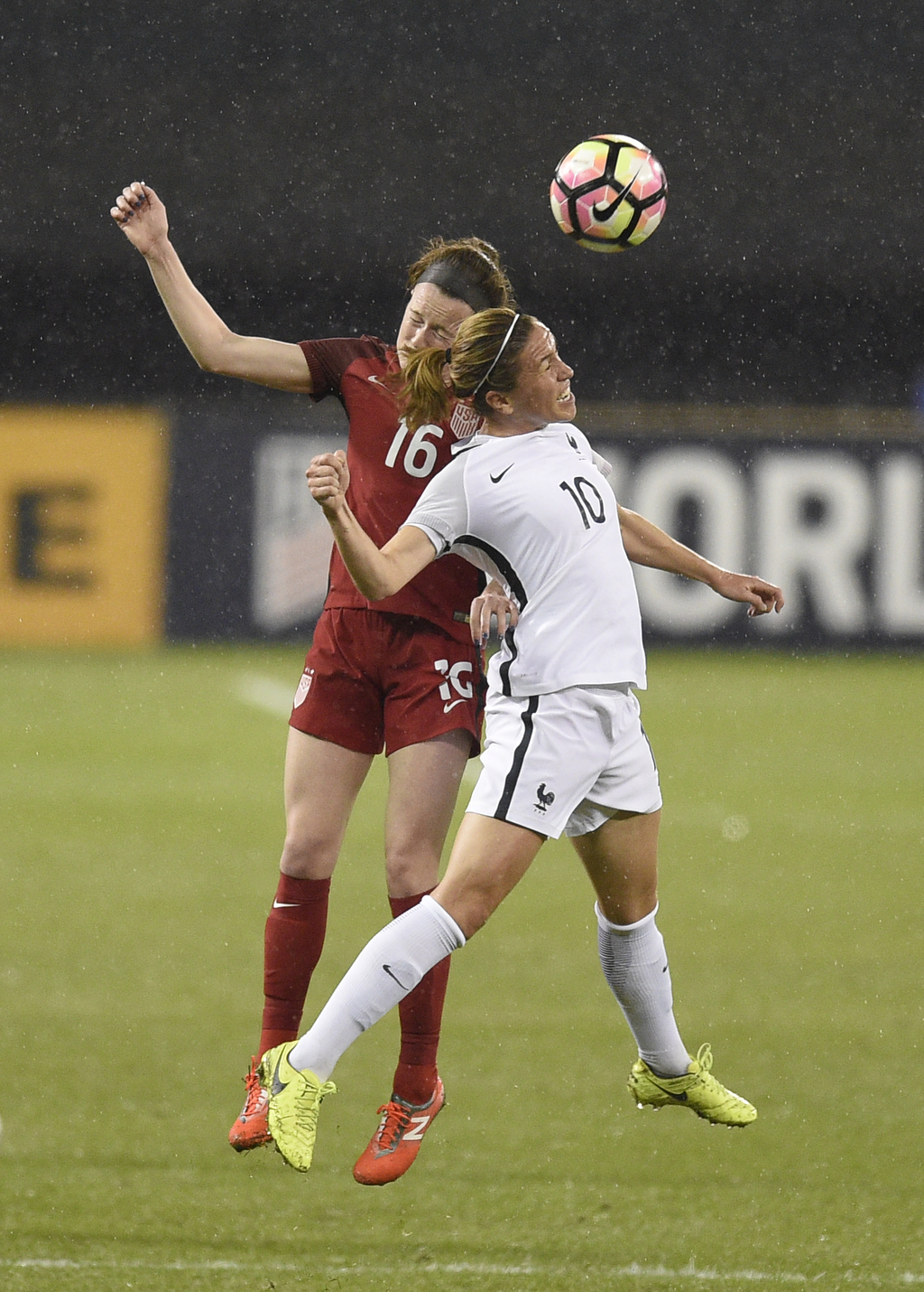 France midfielder Camille Abily (10) battles for the ball against United States midfielder Rose Lavelle (16) during the first half of a...