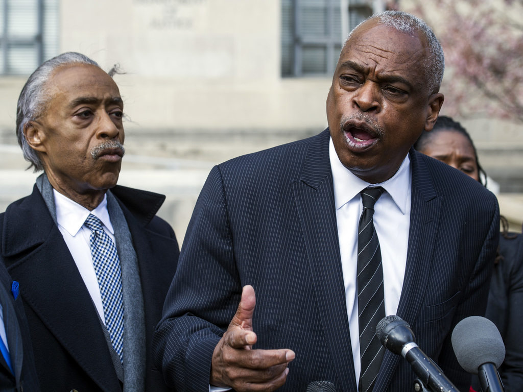 Rev. Al Sharpton listen at left as Wade Henderson, president of the Leadership Conference on Civil and Human Rights, speaks during a ne...