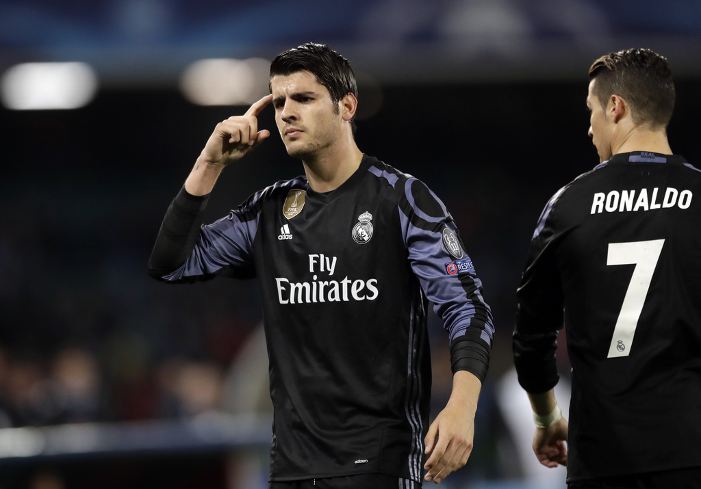Real Madrid's Alvaro Morata gestures after scoring his side's third goal during the Champions League round of 16, second leg, soccer ma...